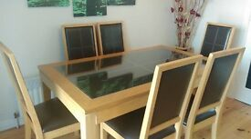 OAK GLASS TOP TABLE WITH SIX CHAIRS. Stylish table and 6 chairs with brown faux leather. £90 ONO