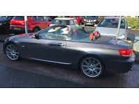 BMW 335i beautiful hard top convertible- metallic grey with dark red leather interior.