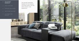 Boconcept Hampton sofa, dark blue sofa with chaise lounge to left & footstool
