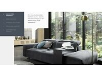 Boconcept Hampton sofa, dark blue sofa with chaise lounge to left & footstool