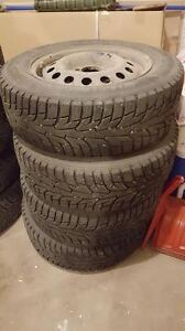 REDUCED!!! 4 Winter tires, only used one season.