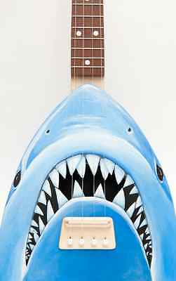 Shark Surfboard & Shark Attack Wetsuit by Diddo, Jaws Ukelele, Shark Table by Bruce Gray, Shark Shoes by Kobi Levi
