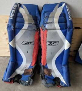 Hockey Goalie Pads and 3 Balls