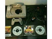 Fully working PlayStation 1 and two classic games.
