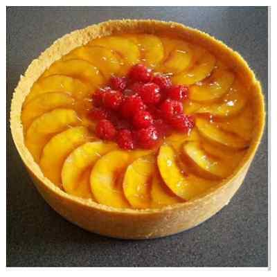Peach melba cheesecake made in a sprung tin