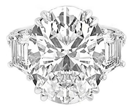 Beautiful 4 carat Oval Shape GIA Certified Diamond with Round & Trapezoid Pla...