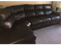 Great condition Black corner sofa with storage and recliner!