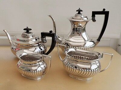FOUR PIECE SILVER PLATED TEA AND COFFEE SET