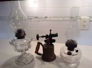 2 Antique oil lamps and a copper blow torch