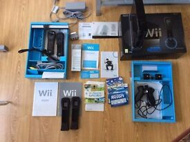 Wii Sports black - good condition with original games. 2 x numchucks etc