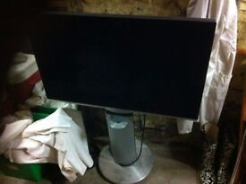Bang and Olufson Beovision TV on motorized stand.
