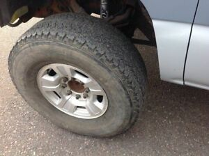 315/70/17 Firestone tires with 8x6.5 wheels.