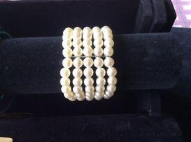 Five stranded faux pearl bracelet