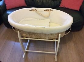 Moses basket with mattress and rocking stand.