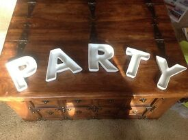 White ceramic snack dishes, set of 5 spelling 'PARTY'