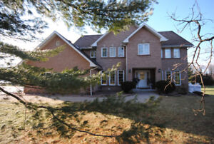 STUNNING EXECUTIVE HOME JUST OFF THE THOUSAND ISLANDS PARKWAY