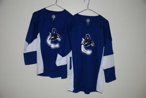 2 Canuck  jerseys, Adult Small, Adult Large