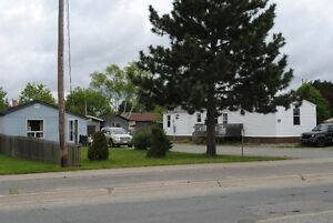 Hanmer-Detached bungalow plus permitted mobile home $169,900