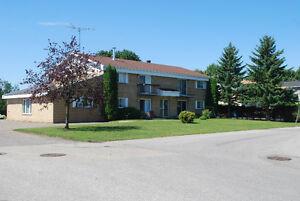 Immeuble à revenus, quintuplexe à St-Jean-de-Matha