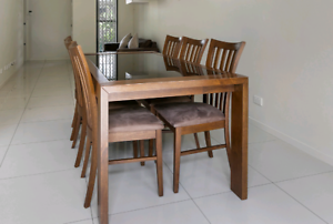 Solid hardwood and glass dining table with 6 matching chairs