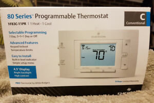 Brand new - programmable thermostat