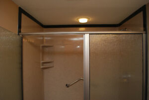 Custom Fiberglass Shower Bases and Solid Surface Panels