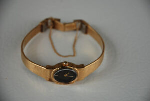 Vintage Seiko Watch (ladies, gold with black face, safety chain)