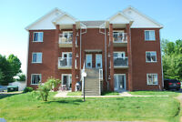 Grand 4 1/2 style condo (secteur Rock Forest)