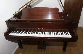 Quality Yamaha Grand Piano, mahogany polished