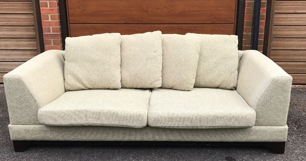 SOFAin Farnham, SurreyGumtree - Sofa Large, Comfy, Light colour with a tinge of green/cream. Can revers cushions and add cushions