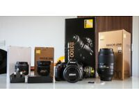 Nikon D3100 with 4 lenses, 2 memory cards and 2 batteries, all boxed and excellent condition.