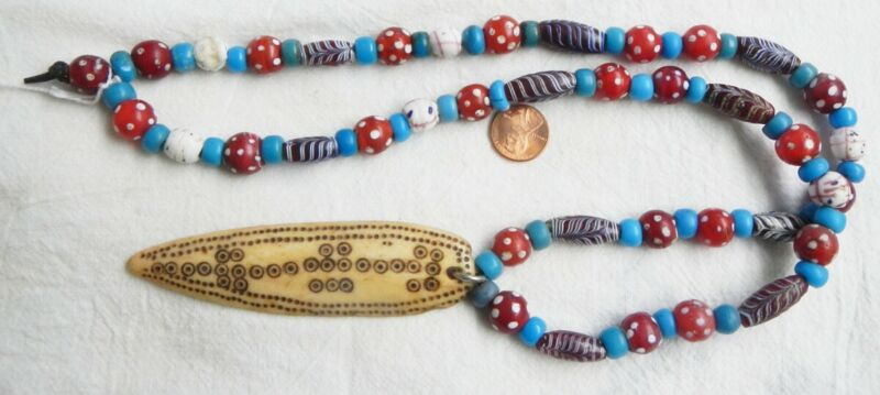 Necklace with Naga Pendant and Old Fancy Trade Beads