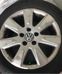 4 Volkswagen tires on rims