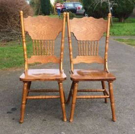 Ornate wooden dining chairs.