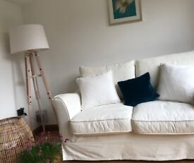 Pair of White Oka loose cover sofas