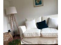 Pair of White Oka loose cover sofas
