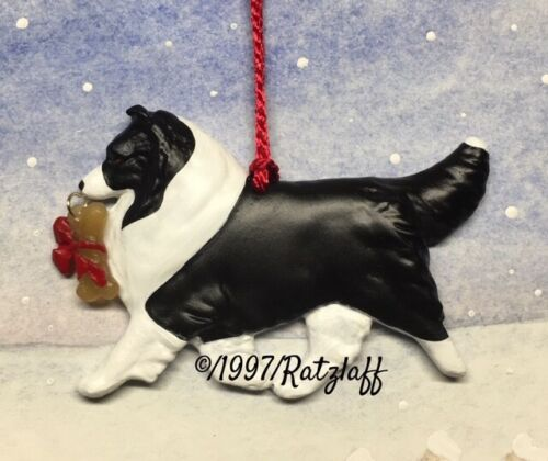 Sheltie with bone charm-bi black-Christmas/holiday dog breed ornament.