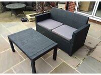 Black Alibert rattan effect garden sofa and table