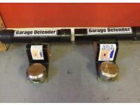 Garage door defender locks