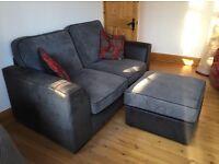 Grey fabric sofa with foot stool