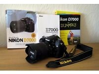 Nikon D7000 with AF-S DX VR 18-105mm zoom lens and skylight filter all in pristine condition
