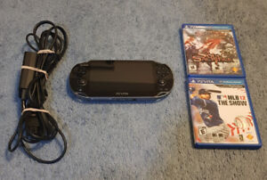 PS Vita System and 2 Games