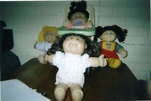 4-Cabbage Patch Kids with Teeth & Coleco Toy Highchair Used