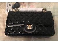 Black Chanel style hand bag