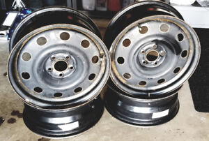 """Set of 4 Black Steel Rims 5 Bolt 17"""" x 7  **One Year Old**"""
