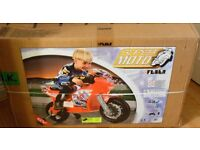 Feber Famosa super kids ride on moto tech racing bike 6V battery operated brand new unopened.