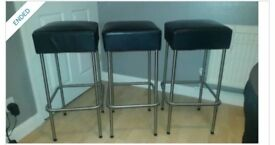 3 black leather look stools