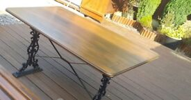 cast iron and wooden table