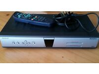 Amstrad Sky box with remote control and power cable, and scart lead. In good working order.