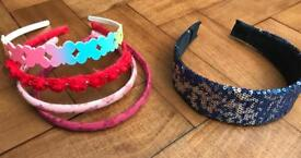 A bundle of girls Alice hair bands from Monsoon & Marks & Spencer